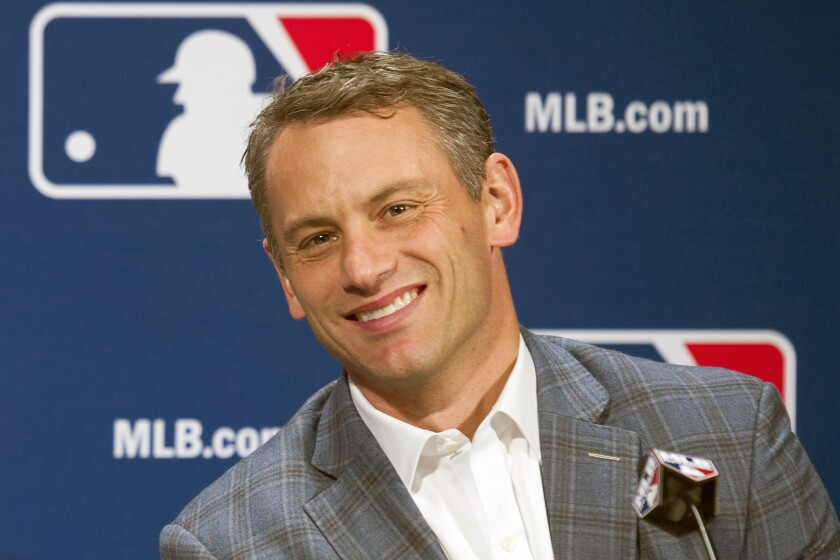FILE - In this Dec. 7, 2016, file photo, Chicago Cubs general manager Jed Hoyer smiles during a press conference in Oxon Hill, Md. Theo Epstein, who transformed the long-suffering Chicago Cubs and helped bring home a drought-busting championship in 2016, is stepping down after nine seasons as the club's president of baseball operations. The team announced Monday, Nov. 16, 2020, Epstein is leaving the organization, and general manager Jed Hoyer is being promoted to take his place. (AP Photo/Cliff Owen, File)