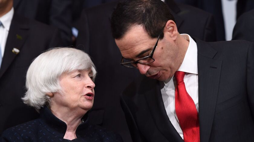 Federal Reserve Chairwoman Janet L. Yellen speaks with Treasury Secretary Steven T. Mnuchin at the G20 meeting in Washington on Oct. 12.