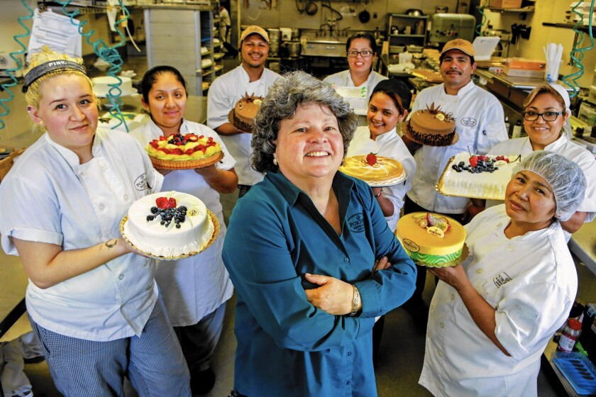 Betty Porto, center, is one of three siblings who run Porto's Bakery & Cafe, the family business founded by their Cuban emigre parents. She's at the chain's Glendale store.