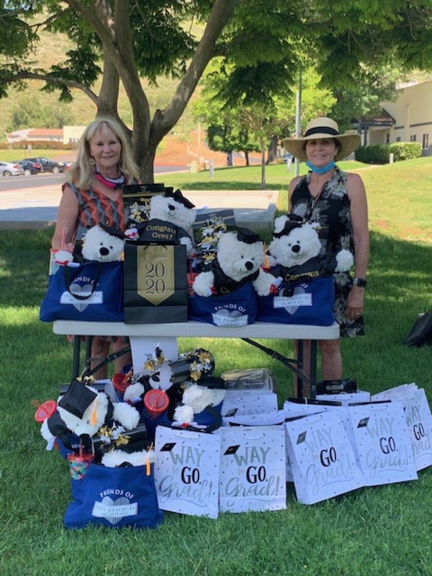 Friends of San Pasqual Academy board members Joan Scott and Kathy Lathrum handed out special graduation gifts for every senior at San Pasqual Academy. Each graduate is offered a scholarship to further their education. Friends of San Pasqual is currently supporting over 80 graduates, who are attending various colleges and vocational schools.