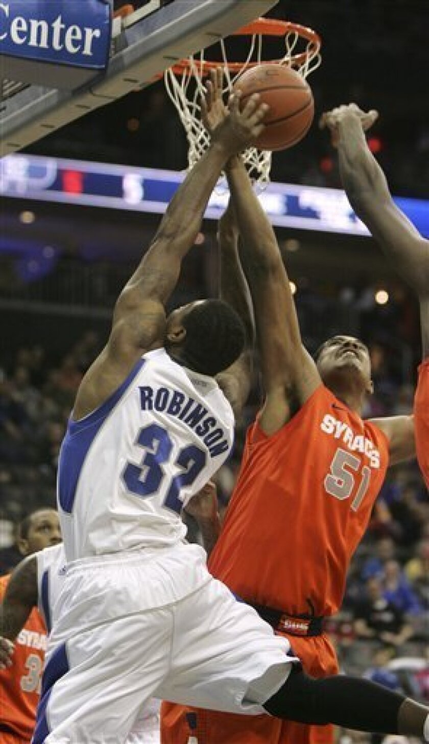 Seton Hall's Jeff Robinson (32) attempts a shot as Syracuse's Fab Melo (51) looks to block it during the first half of an NCAA college basketball game at the Prudential Center, Saturday, Jan. 8, 2011, in Newark, N.J. (AP Photo/Rich Schultz)