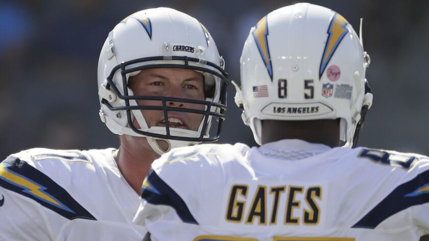 CARSON, CA, SUNDAY, SEPTEMBER 9, 2018 - Chargers quarterback Philip Rivers talks with tight end Anto