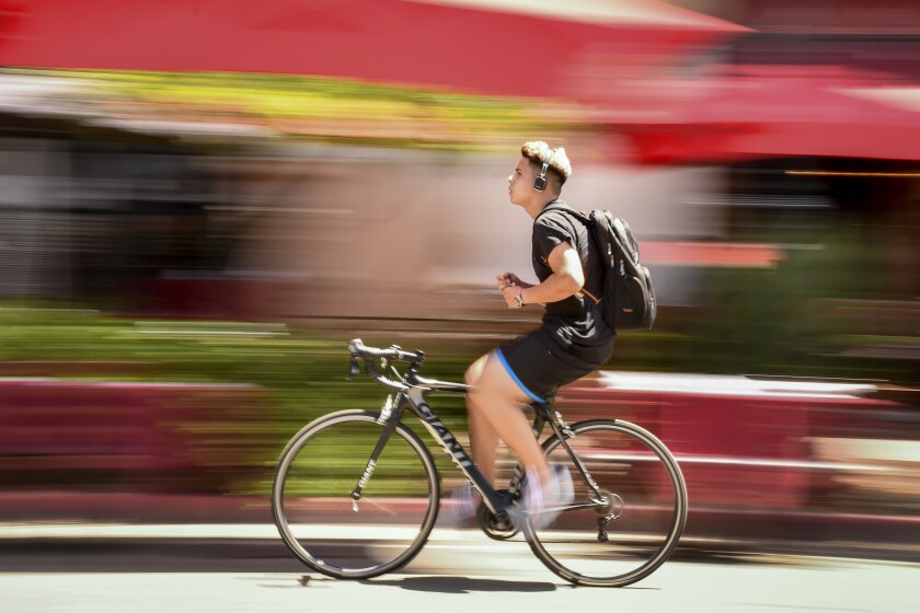 Santa Barbara has banned cars from part of State Street. Bikes are allowed, but riding hands-free like this is frowned upon.