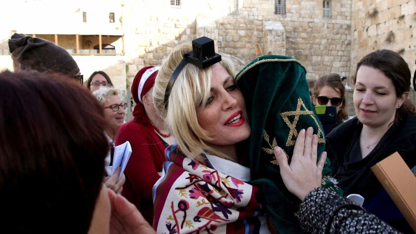 In 2016, a member of the liberal Jewish religious group Women of the Wall wears phylacteries and Tal