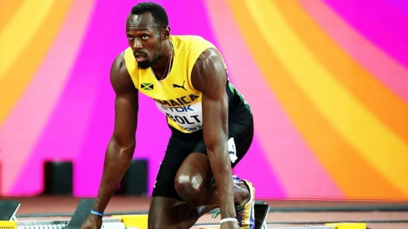 Usain Bolt prepares for the start of his 100 meters heat Aug. 4.