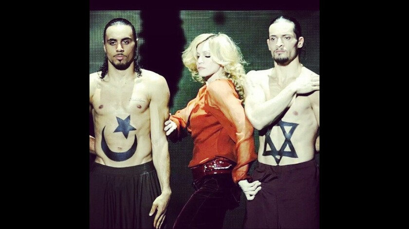 """Madonna posted this image Thursday on Instagram, captioning it: """"No Separation! We all bleed the same color! #ceasefire #peaceinthemiddleeast #livingforlove."""" She followed up Friday by celebrating a short-lived ceasefire with a photo of the men holding hands."""