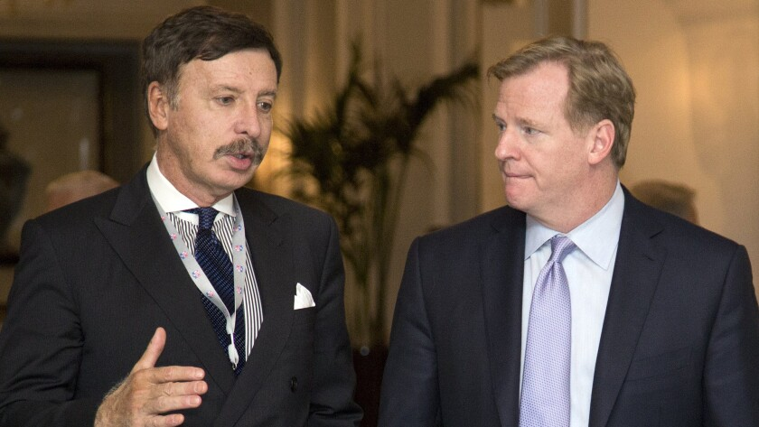 St. Louis Rams owner Stan Kroenke, left, speaks with NFL Commissioner Roger Goodell during a break at an NFL owners' meeting in Washington on Oct. 8, 2013.