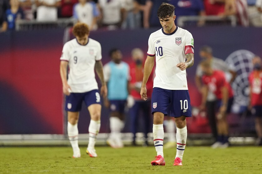 United States forwards Christian Pulisic (10) and Josh Sargent (9) leave the pitch following a 1-1 draw with Canada