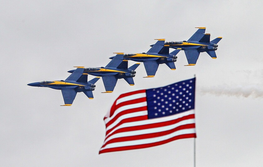 Members of the Navy Blue Angels team make a pass during preview day of the Miramar Air Show.