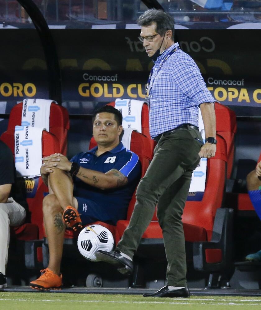 El Salvador head coach Hugo Perez stops an out of bounds ball