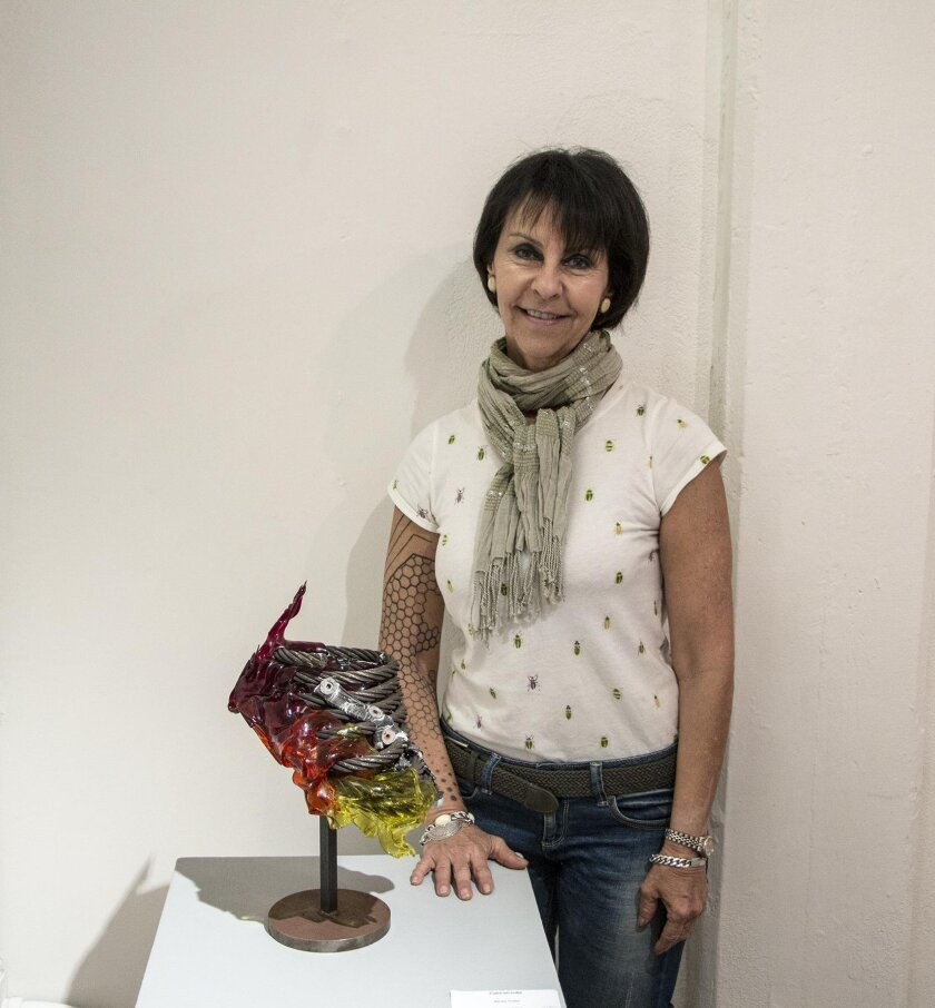 Guttin with her glass and steel sculpture, 'Calor en Color' — Heat in Color.