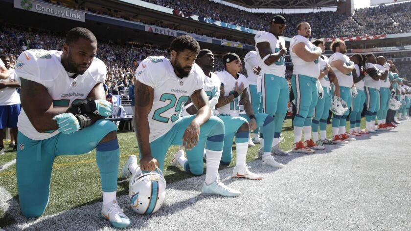 FILE - In this Sept. 11, 2017 file photo, from left, Miami Dolphins' Jelani Jenkins, Arian Foster, M