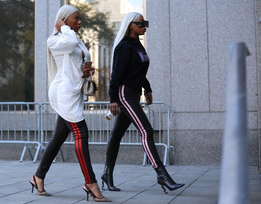Shannade Clermont (l.) and her sister Shannon (r.) arrive at the Daniel Patrick Moynihan Federal Courthouse on November 1, 2018 in New York. Schannade pleaded guilty today; she had been accused of using the debit card of a dead man to whom she had provided sex services.