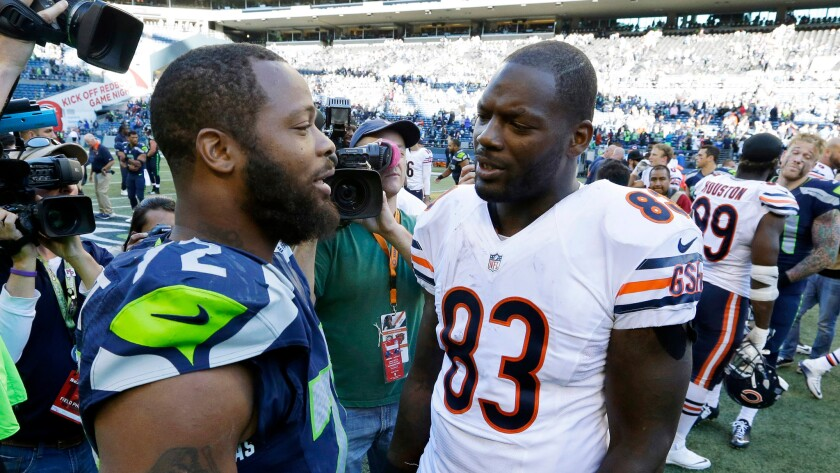 Michael, left, and Martellus Bennett talk the Seattle-Chicago game on Sept. 27, 2015. Michael is a defensive end for the Seahawks; Martellus is now a New England tight end.