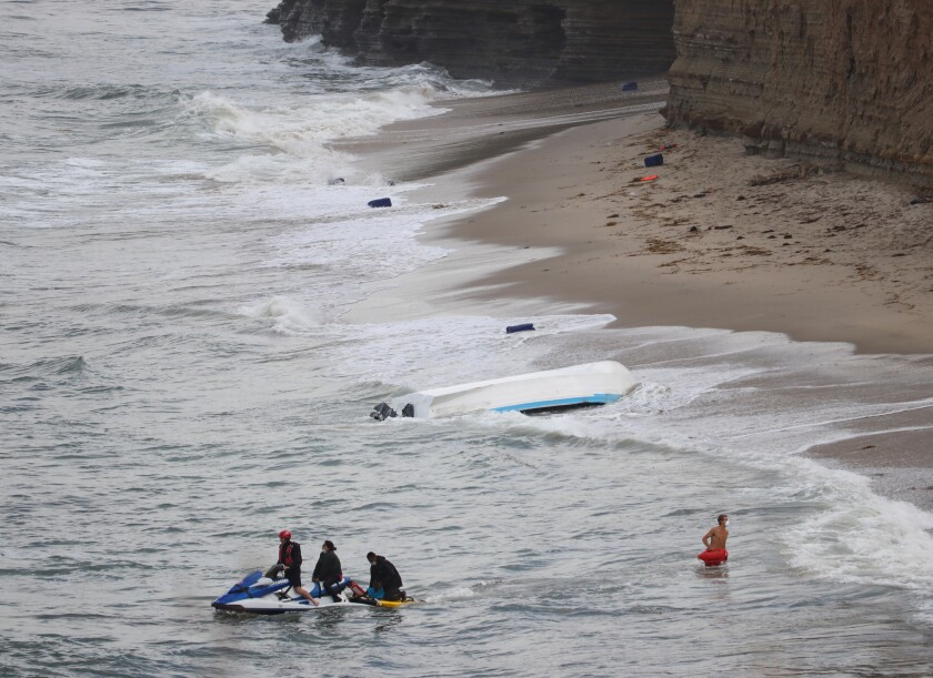 A panga that officials said was being used to smuggle people into the country capsized in Sunset Cliffs early Monday; 15 people were detained and turned over to Border Patrol agents.