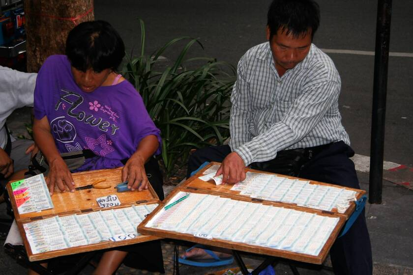 Lottery ticket vendors on the streets of Bangkok are concerned that they will lose their jobs if Thailand's government introduces lottery machines.