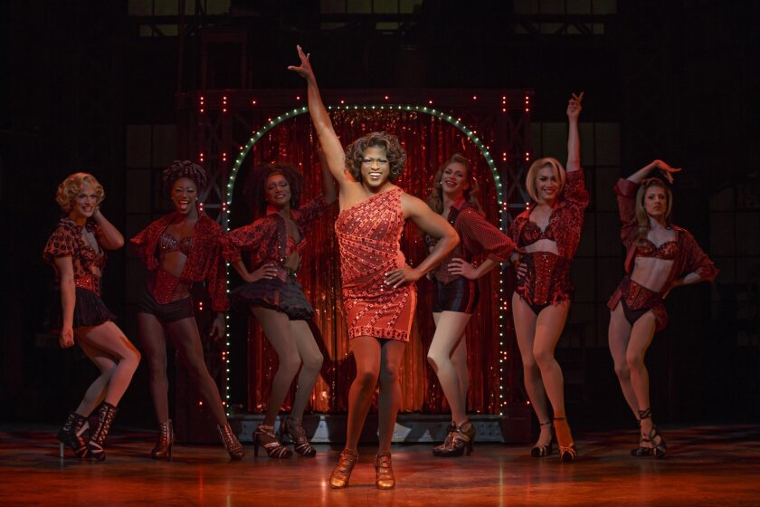 """This image released by The O and M Company shows Wayne Brady during a performance of """"Kinky Boots."""" This weekend Brady is replacing Tony Award-winner Billy Porter as the drag queen Lola for a four-month run. (Joan Marcus/The O and M Company via AP)"""
