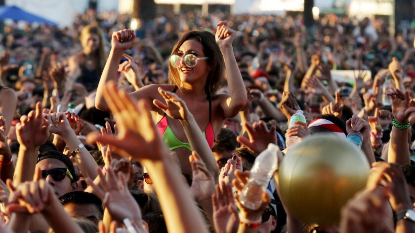 POMONA, CALIF. - AUG. 1, 2015. Fans watch a performance by Odezsa during Hard Summer at the Fairplex
