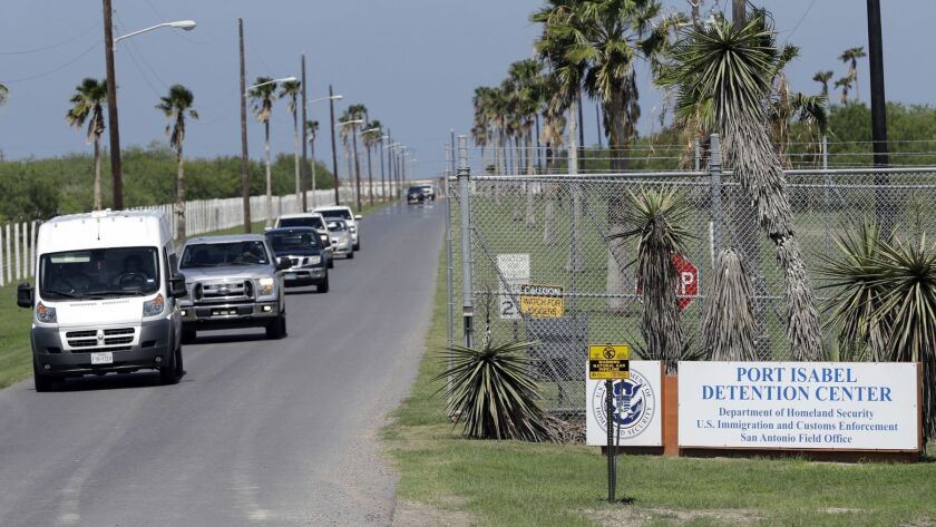 Vehicles leave the Port Isabel Detention Center, which holds detainees of Immigration and Customs Enforcement.