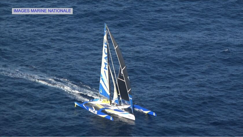 A screen shot taken Saturday from a French Marine Nationale video shows skipper Francois Gabart's Macif trimaran.