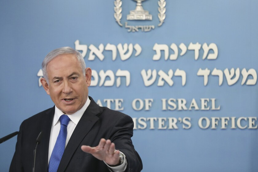 """Israel's Prime Minister Benjamin Netanyahu announces full diplomatic ties will be established with the United Arab Emirates, during a news conference on Thursday, Aug. 13, 2020 in Jerusalem. In a nationally broadcast statement, Netanyahu said the """"full and official peace"""" with the UAE would lead to cooperation in many spheres between the countries and a """"wonderful future"""" for citizens of both countries. (Abir Sultan/Pool Photo via AP)"""
