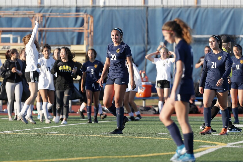 Marina's McKenna Pua (20) looks on after the Vikings lose 3-1 to Capistrano Valley in the quarterfinals of the CIF Southern Section Division 2 playoffs on Wednesday in Huntington Beach.