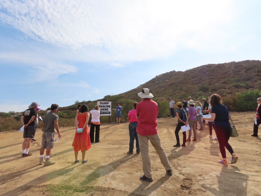 Diane Hazard, Solana Center director of education, leads the group in a tour of the compost demonstration site.