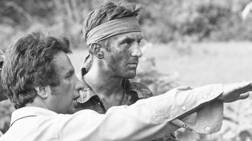 "Michael Cimino, on the set with Robert De Niro for the 1978 film ""The Deer Hunter."""