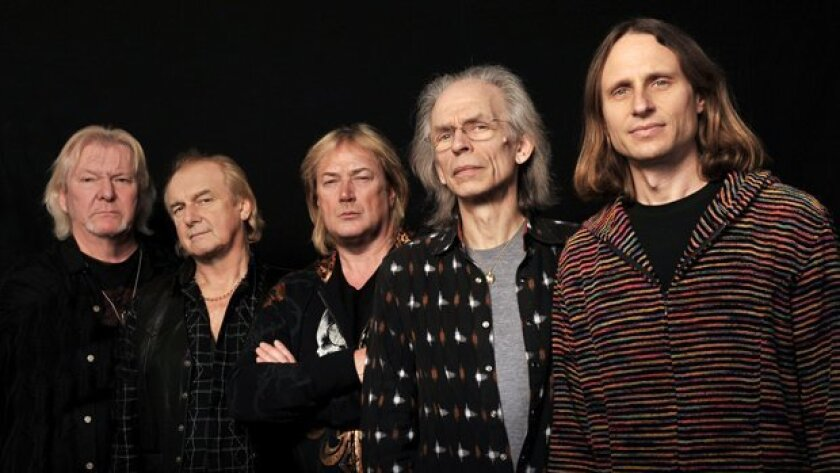 Chris Squire (far left), the bassist in the pioneering English progessive-rock band Yes, died Saturday at the age of 67. the group celebrated its 45th anniversary in 2013. Its lone American member and newest addition, lead singer Jon Davison (far right), used to be the vocalist in Roundabout, a San Diego Yes cover band.