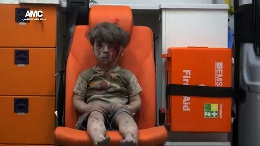 An injured boy sits alone in an ambulance after an attack in Aleppo in an image from video posted by a Syrian opposition group on Aug. 17, 2016.