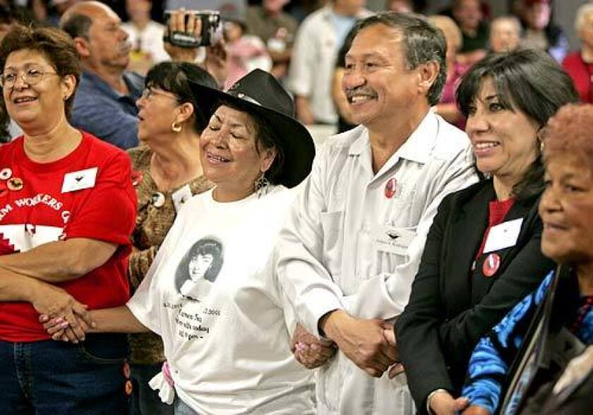 UFW President Arturo Rodriguez joins hands with his fiancee, Sonia Hernandez, right, during a reunion in Delano, Calif., in September marking the 40th anniversary of the grape strike that began there. Today the UFW doesn't have a single contract covering workers in the table grape industry.