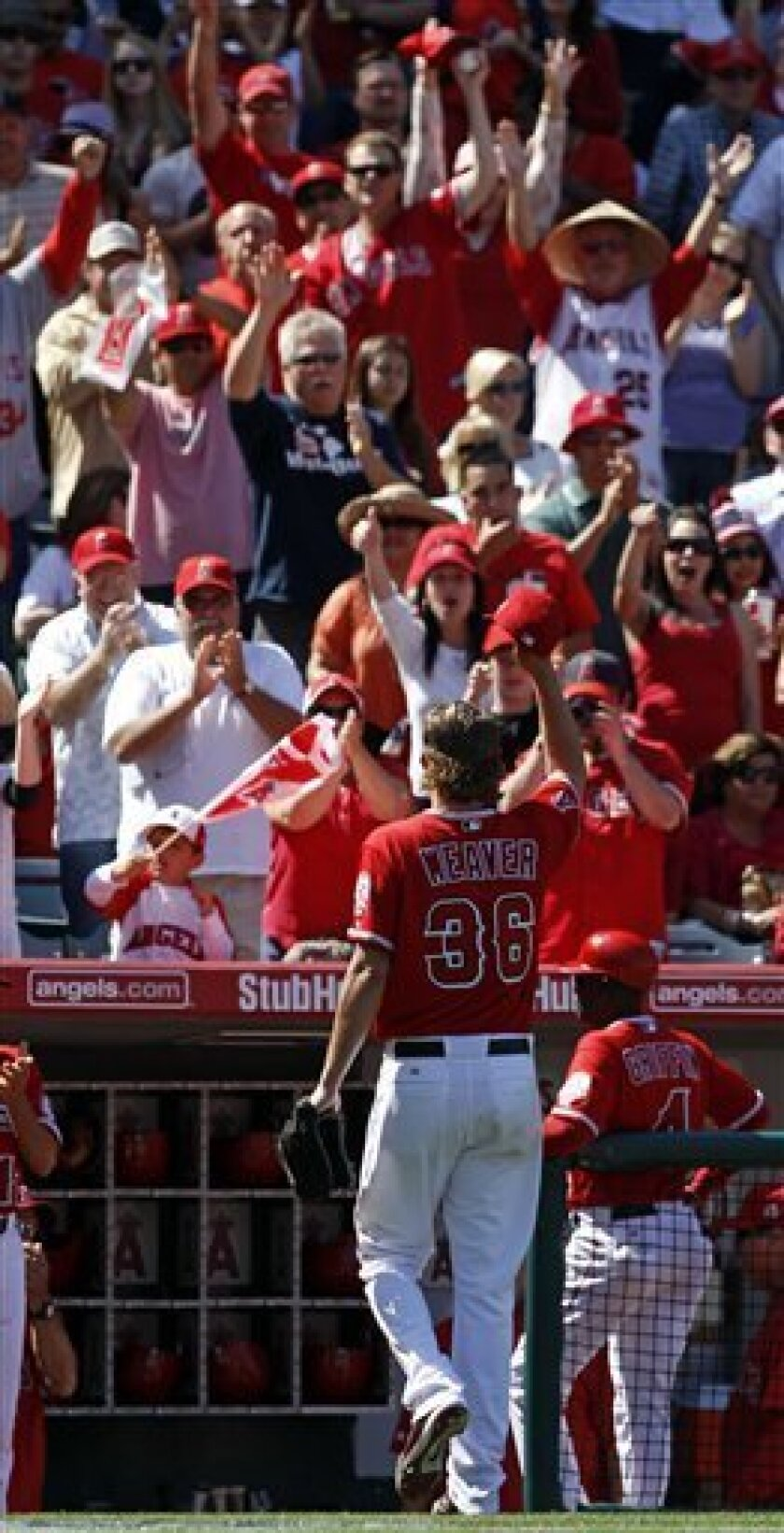 Los Angeles Angels starting pitcher Jered Weaver waves as he leaves the field against the Toronto Blue Jays during the eighth inning of a baseball game in Anaheim, Calif., Sunday, April 10, 2011. (AP Photo/Chris Carlson)