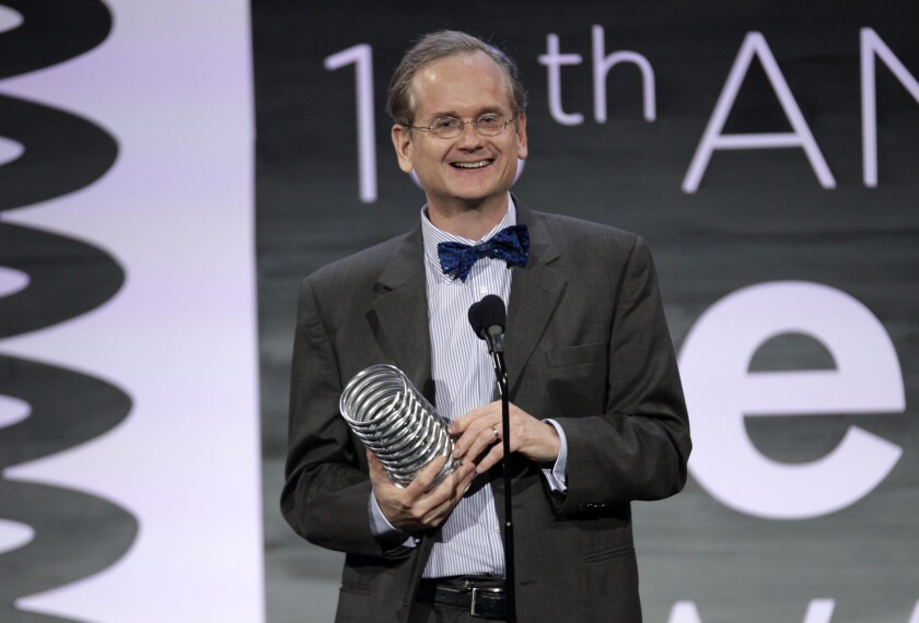 Law professor Larry Lessig appears onstage at the 2014 Webby Awards in New York.
