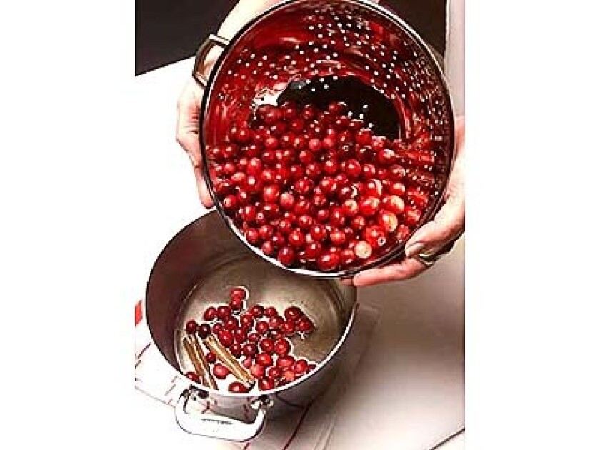 Add cranberries to boiling syrup. Cook cranberries until they begin to pop, then remove from heat.
