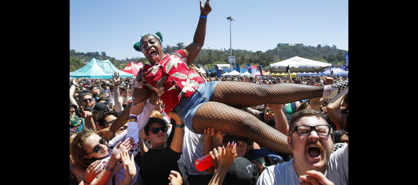 Medina Ali, 21, who traveled here from London, crowd surfs as band Four Year Strong plays.