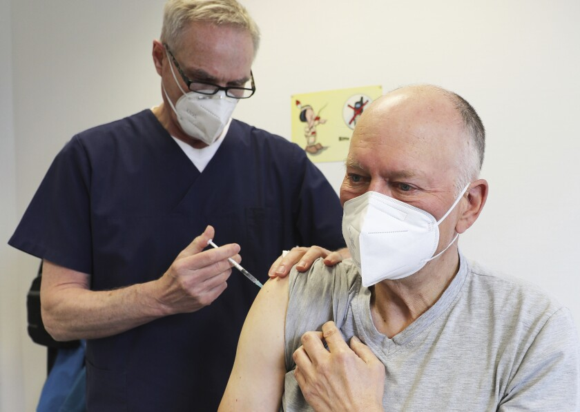 A man receives the AstraZeneca COVID-19 vaccine in Germany.