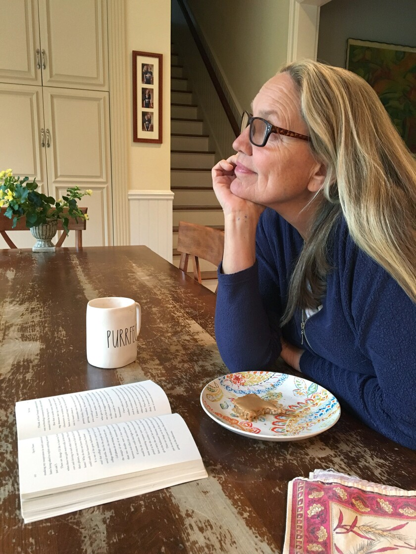 Author Nina Sankovitch reading at her kitchen table. Sankovitch's new book, American Rebels: How the