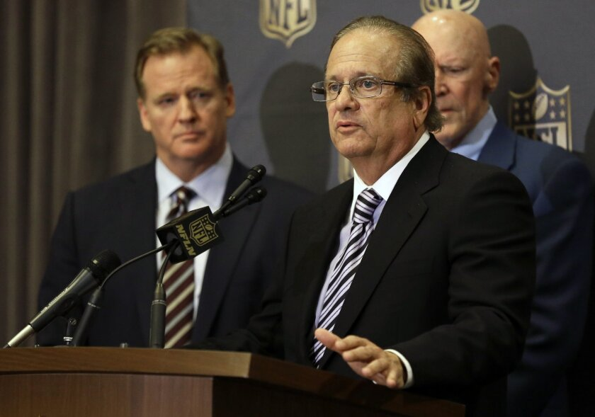 FILE - In this Jan. 12, 2016, file photo, NFL Commissioner Roger Goodell, left, listens as San Diego Chargers owner Dean Spanos talks to the media after team owners voted in Houston to allow the St. Louis Rams to move to a new stadium just outside Los Angeles, with the Chargers having an option to