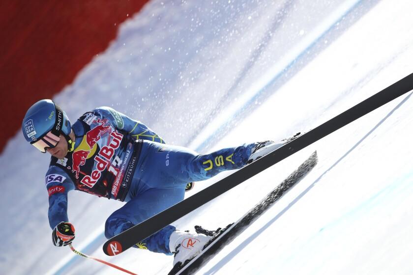 United States' Ryan Cochran Siegle falls during an alpine ski, men's World Cup downhill in Kitzbühel, Austria, Friday, Jan. 22, 2021. (AP Photo/Marco Trovati)
