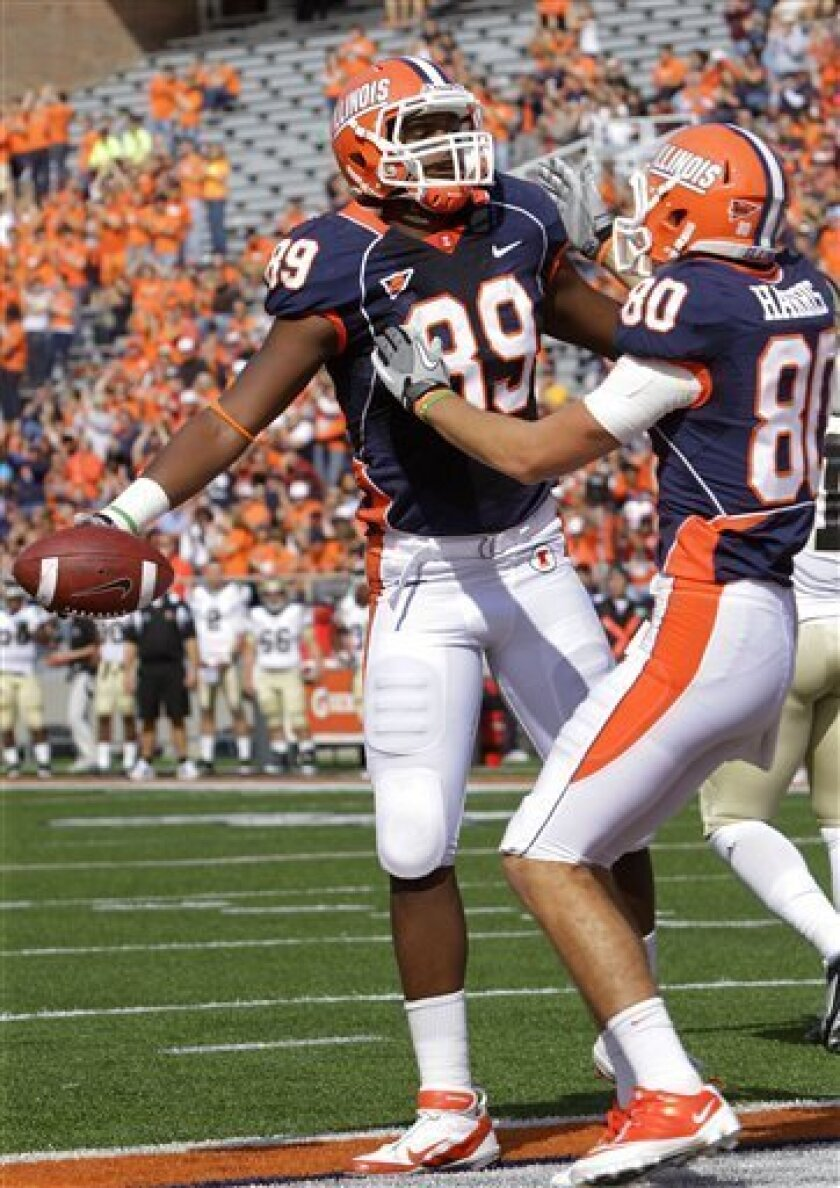 Illinois tight end Evan Wilson (89) celebrates with Illinois wide receiver Spencer Harris (80) after scoring a touchdown during the first half of an NCAA college football game against Western Michigan, Saturday, Sept. 24, 2011, in Champaign, Ill. Illinois defeated Western Michigan 23-20. (AP Photo/Seth Perlman)