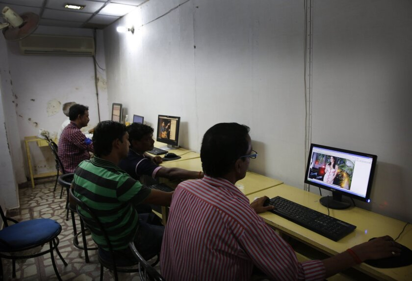 Indian youth use the Internet at a cyber cafe in Allahabad, India, on Monday.