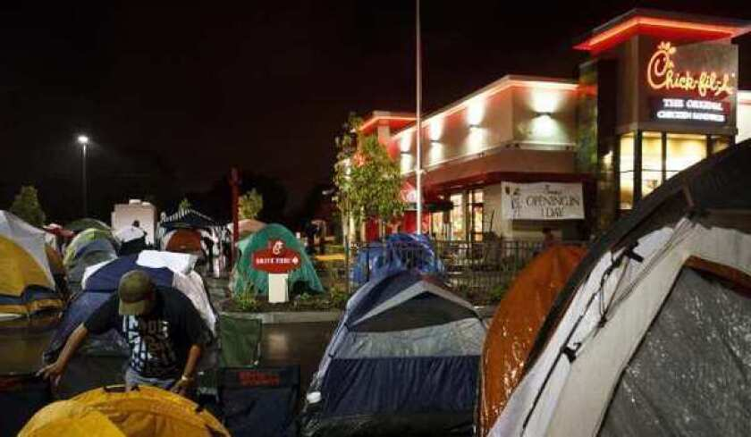 Chick-fil-A fans camp out in front of a Costa Mesa restaurant while waiting for its grand opening.