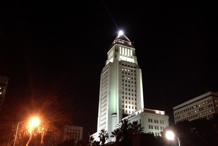 The Lindbergh beacon lights up above L.A. City Hall.