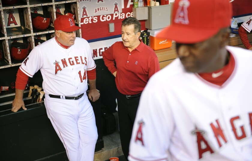 Angels Manager Mike Scioscia and owner Arte Moreno chat before a game in 2013.