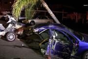 Suspected DUI crash into light pole snaps car in half