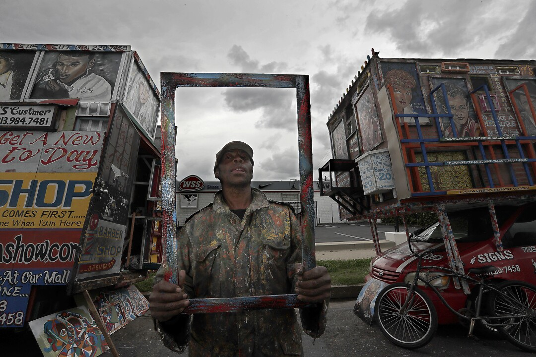 """Pascacio DaVinci, 65, uses two campers as housing and storage for his artwork. He has been a street vendor in South L.A. for more than 20 years, and is fatalistic about the coronavirus pandemic. """"If it's my time to die, it's my time to die,"""" he said. """"Mask or no mask, it won't matter."""""""