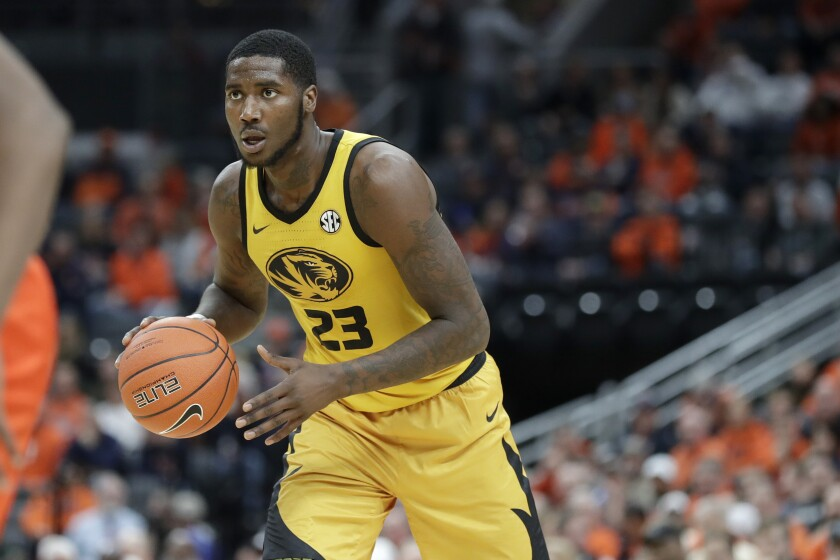 FILE - Missouri's Jeremiah Tilmon looks to pass during the second half of an NCAA college basketball game against Illinois in St. Louis, in this Saturday, Dec. 21, 2019, file photo. Tilmon flirted with the NBA before returning to Columbia. (AP Photo/Jeff Roberson, FIile)