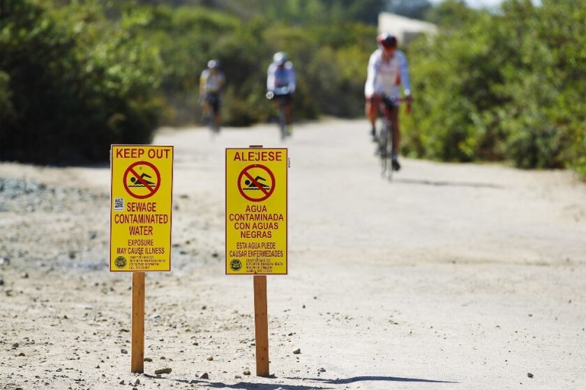 Signs warning the public of contaminated water in Imperial Beach's Border Field State Park.