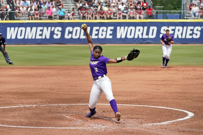 FILE - In this Monday, June 7, 2021, file photo, James Madison's Odicci Alexander pitches in the first inning of an NCAA Women's College World Series softball game against Oklahoma in Oklahoma City. Alexander emerging as a national sensation when a record-setting Women's College World Series last week capped off a dynamic year of increased visibility for NCAA Division I women's sports. (AP Photo/Sue Ogrocki, File)