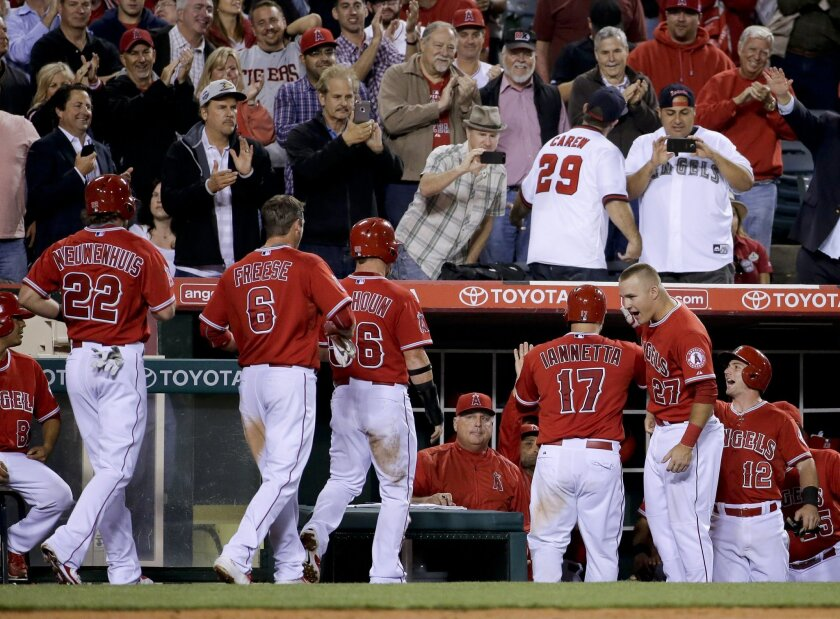 Los Angeles Angels' Chris Iannetta (17) celebrates his grand slam against the Detroit Tigers during the seventh inning of a baseball game in Anaheim, Calif., Thursday, May 28, 2015. (AP Photo/Chris Carlson)